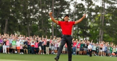 AUGUSTA, GEORGIA - APRIL 14: Tiger Woods of the United States celebrates after sinking his putt on the 18th green to win during the final round of the Masters at Augusta National Golf Club on April 14, 2019 in Augusta, Georgia. (Photo by Kevin C. Cox/Gett