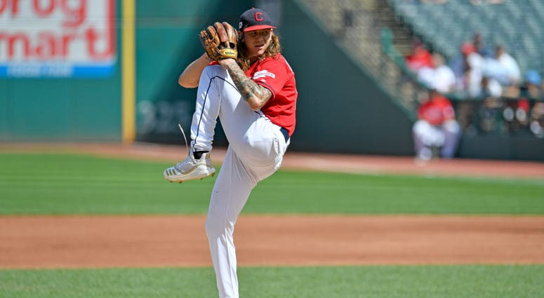 CLEVELAND, OHIO - SEPTEMBER 14: Starting pitcher Mike Clevinger #52 of the Cleveland Indians pitches during the first inning against the Minnesota Twins during the first game of a double header at Progressive Field on September 14, 2019 in Cleveland, Ohio