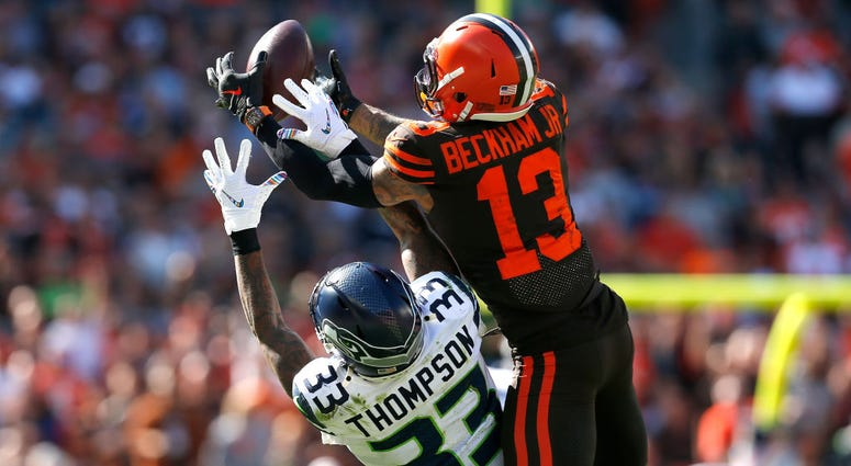 CLEVELAND, OH - OCTOBER 13: Odell Beckham Jr. #13 of the Cleveland Browns catches a pass over the defense of Tedric Thompson #33 of the Seattle Seahawks during the second quarter at FirstEnergy Stadium on October 13, 2019 in Cleveland, Ohio. (Photo by Kir