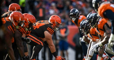 DENVER, CO - NOVEMBER 3: The Cleveland Browns offense lines up behind JC Tretter #64 in the first quarter of a game against the Denver Broncos at Empower Field at Mile High on November 3, 2019 in Denver, Colorado. (Photo by Dustin Bradford/Getty Images)