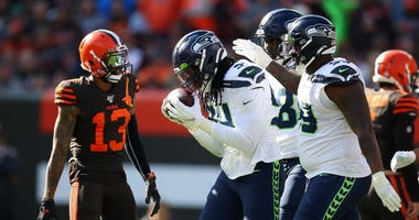 CLEVELAND, OHIO - OCTOBER 13: Ezekiel Ansah #94 of the Seattle Seahawks celebrates his third quarter fumble recovery with teammates in front of Odell Beckham #13 of the Cleveland Browns at FirstEnergy Stadium on October 13, 2019 in Cleveland, Ohio. (Photo