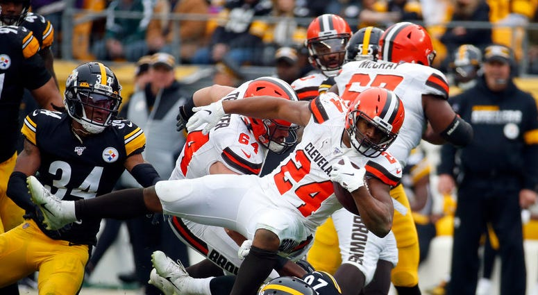 PITTSBURGH, PA - DECEMBER 01: Nick Chubb #24 of the Cleveland Browns rushes against Mike Hilton #28 and Terrell Edmunds #34 of the Pittsburgh Steelers in the first half on December 1, 2019 at Heinz Field in Pittsburgh, Pennsylvania. (Photo by Justin K. Al