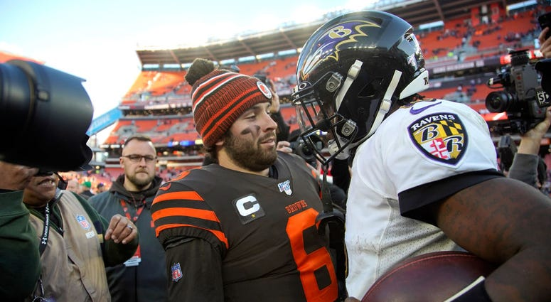 CLEVELAND, OH - DECEMBER 22: Lamar Jackson #8 of the Baltimore Ravens shakes hands with Baker Mayfield #6 of the Cleveland Browns after the game at FirstEnergy Stadium on December 22, 2019 in Cleveland, Ohio. Baltimore defeated Cleveland 31-15. (Photo by
