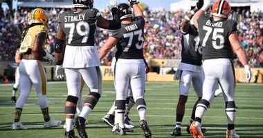 ORLANDO, FLORIDA - JANUARY 26: Ronnie Stanley #79, Marshal Yanda #73 of the Baltimore Ravens, and Joel Bitonio #75 of the Cleveland Browns celebrate the touchdwown in the first half of the 2020 NFL Pro Bowl at Camping World Stadium on January 26, 2020 in