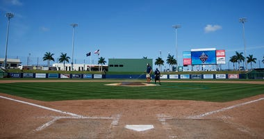VARIOUS CITIES, - MARCH 12: Grounds crew workers clean up the field after the Grapefruit League spring training game between the Washington Nationals and the New York Yankees at FITTEAM Ballpark of The Palm Beaches on March 12, 2020 in West Palm Beach, Fl