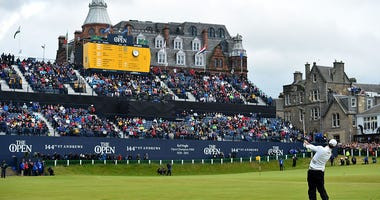 ST ANDREWS, SCOTLAND - JULY 20: Zach Johnson of the United States plays his approach shot to the 18th green in the playoff during the final round of the 144th Open Championship at The Old Course on July 20, 2015 in St Andrews, Scotland. (Photo by Stuart F
