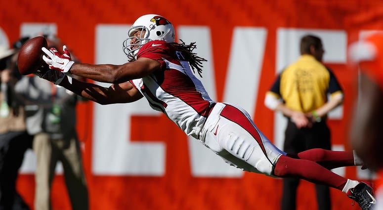 CLEVELAND, OH - NOVEMBER 01: Larry Fitzgerald #11 of the Arizona Cardinals can't pull in a second quarter catch while playing the Cleveland Browns at FirstEnergy Stadium on November 1, 2015 in Cleveland, Ohio. (Photo by Gregory Shamus/Getty Images)