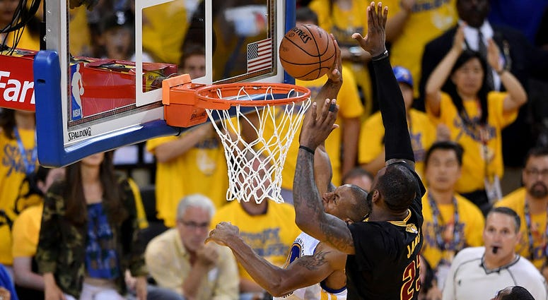 OAKLAND, CA - JUNE 19: LeBron James #23 of the Cleveland Cavaliers blocks a shot by Andre Iguodala #9 of the Golden State Warriors in Game 7 of the 2016 NBA Finals at ORACLE Arena on June 19, 2016 in Oakland, California. NOTE TO USER: User expressly ackno