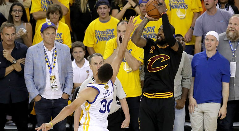 OAKLAND, CA - JUNE 19: Kyrie Irving #2 of the Cleveland Cavaliers shoots a three-point basket against the Golden State Warriors in Game 7 of the 2016 NBA Finals at ORACLE Arena on June 19, 2016 in Oakland, California. NOTE TO USER: User expressly acknowle