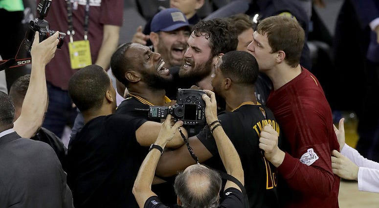OAKLAND, CA - JUNE 19: LeBron James #23 and Kevin Love #0 and the Cleveland Cavaliers celebrate after defeating the Golden State Warriors 93-89 in Game 7 of the 2016 NBA Finals at ORACLE Arena on June 19, 2016 in Oakland, California. NOTE TO USER: User ex
