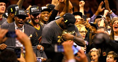 OAKLAND, CA - JUNE 19: LeBron James #23 of the Cleveland Cavaliers holds the Larry O'Brien Championship Trophy after defeating the Golden State Warriors 93-89 in Game 7 of the 2016 NBA Finals at ORACLE Arena on June 19, 2016 in Oakland, California. NOTE T