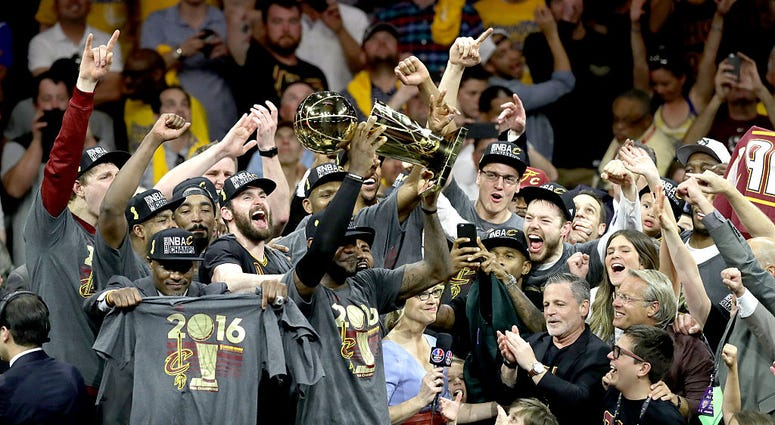 OAKLAND, CA - JUNE 19: LeBron James #23 of the Cleveland Cavaliers celebrates with the Larry O'Brien Championship Trophy after defeating the Golden State Warriors 93-89 in Game 7 of the 2016 NBA Finals at ORACLE Arena on June 19, 2016 in Oakland, Californ