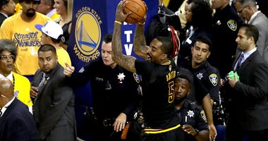 OAKLAND, CA - JUNE 19: J.R. Smith #5 of the Cleveland Cavaliers grabs the game ball at the end of Game 7 after defeating the Golden State Warriors in the 2016 NBA Finals at ORACLE Arena on June 19, 2016 in Oakland, California. NOTE TO USER: User expressly