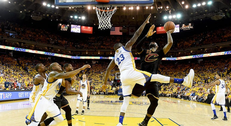 OAKLAND, CA - JUNE 19: LeBron James #23 of the Cleveland Cavaliers takes a shot against Draymond Green #23 of the Golden State Warriors in Game 7 of the 2016 NBA Finals at ORACLE Arena on June 19, 2016 in Oakland, California. NOTE TO USER: User expressly