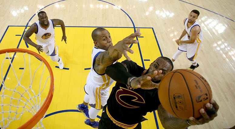 OAKLAND, CA - JUNE 19: Andre Iguodala #9 of the Golden State Warriors defends LeBron James #23 of the Cleveland Cavaliers in Game 7 of the 2016 NBA Finals at ORACLE Arena on June 19, 2016 in Oakland, California. NOTE TO USER: User expressly acknowledges a