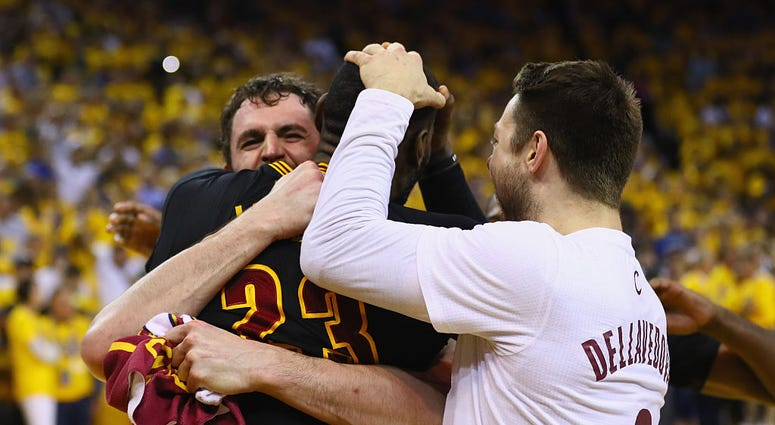 OAKLAND, CA - JUNE 19: LeBron James #23, Kevin Love #0, and Matthew Dellavedova #8 of the Cleveland Cavaliers celebrate after defeating the Golden State Warriors 93-89 in Game 7 of the 2016 NBA Finals at ORACLE Arena on June 19, 2016 in Oakland, Californi