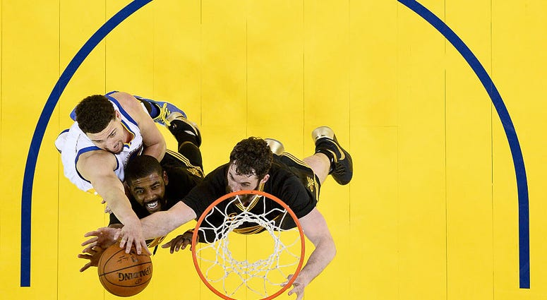 OAKLAND, CA - JUNE 19: Kyrie Irving #2 and Kevin Love #0 of the Cleveland Cavaliers go after the ball in front of Klay Thompson #11 of the Golden State Warriors in the second half in Game 7 of the 2016 NBA Finals at ORACLE Arena on June 19, 2016 in Oaklan