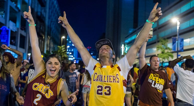 CLEVELAND, OH - JUNE 19: Cleveland Cavaliers fans celebrate in the street after the Cavaliers defeated the Golden State Warriors to win the NBA Championship on June 19, 2016 in Cleveland, Ohio. The victory brings the first professional sports championship
