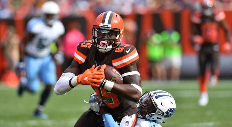 CLEVELAND, OH - OCTOBER 22: David Njoku #85 of the Cleveland Browns is tackled by Kevin Byard #31 of the Tennessee Titans in the third quarter at FirstEnergy Stadium on October 22, 2017 in Cleveland, Ohio. (Photo by Jason Miller/Getty Images)