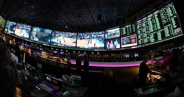 LAS VEGAS, NV - MARCH 15: (EDITORS NOTE: This image was shot with a fisheye lens.) Guests attend a viewing party for the NCAA Men's College Basketball Tournament inside the 25,000-square-foot Race & Sports SuperBook at the Westgate Las Vegas Resort & Casi