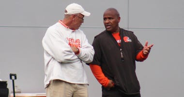 Browns general manager John Dorsey and head coach Hue Jackson speak during a training camp practice.