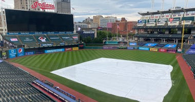 A general view of Progressive Field with the tarp on the field
