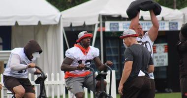 Browns receiver Josh Gordon rides an exercise bike on Aug. 21, 2018