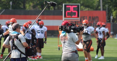 An NFL Films crew films for HBO's Hard Knocks during practice