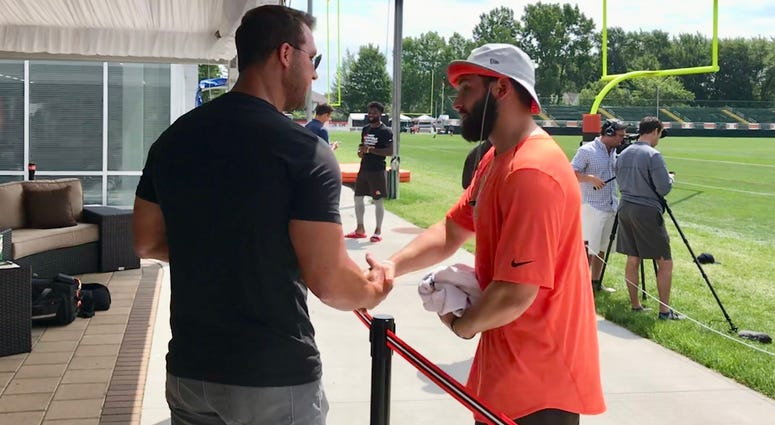Former Browns No. 1 pick and quarterback Tim Couch shakes hands with Baker Mayfield, this year's No. 1 overall pick on July 30, 2018.