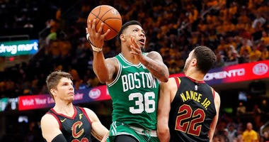 May 19, 2018; Cleveland, OH, USA; Boston Celtics guard Marcus Smart (36) drives to the basket in between Cleveland Cavaliers forward Larry Nance Jr. (22) and guard Kyle Korver (26) during the second half in game three of the Eastern conference finals of t