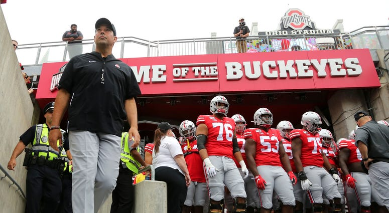 Ohio State Buckeyes head coach Ryan Day walks to the field with his team before the game against the Florida Atlantic Owls at Ohio Stadium