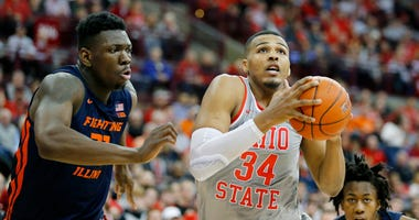 Mar 5, 2020; Columbus, Ohio, USA; Ohio State Buckeyes forward Kaleb Wesson (34) goes in for two past Illinois Fighting Illini center Kofi Cockburn (left)during the second half at Value City Arena.
