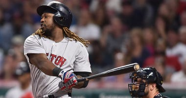 Aug 22, 2017; Cleveland, OH, USA; Boston Red Sox designated hitter Hanley Ramirez (13) hits an RBI single during the first inning against the Cleveland Indians at Progressive Field. Mandatory Credit: Ken Blaze-USA TODAY Sports