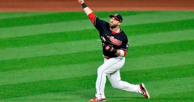 Sep 26, 2017; Cleveland, OH, USA; Cleveland Indians center fielder Jason Kipnis (22) throws from the outfield in the sixth inning against the Minnesota Twins at Progressive Field.