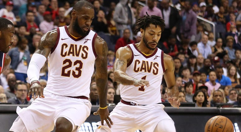 Nov 3, 2017; Washington, DC, USA; Cleveland Cavaliers forward LeBron James (23) and Cavaliers guard Derrick Rose (1) reach for a loose ball against the Washington Wizards at Capital One Arena. Mandatory Credit: Geoff Burke-USA TODAY Sports
