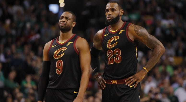 Jan 3, 2018; Boston, MA, USA; Cleveland Cavaliers guard Dwyane Wade (9) and forward LeBron James (23) talk on the court against the Boston Celtics in the first quarter at TD Garden. Mandatory Credit: David Butler II-USA TODAY Sports