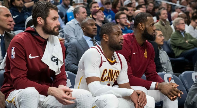 Jan 8, 2018; Minneapolis, MN, USA; Cleveland Cavaliers forward Kevin Love (left) and guard Dwyane Wade (middle) and forward LeBron James (right) sit on the bench in the fourth quarter against the Minnesota Timberwolves at Target Center. Mandatory Credit: