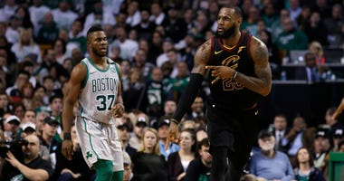 Feb 11, 2018; Boston, MA, USA; Cleveland Cavaliers forward LeBron James (23) celebrates after a basket as Boston Celtics forward Semi Ojeleye (37) looks on during the third quarter of Cleveland's 121- 99 win at TD Garden.