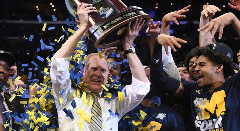 Mar 24, 2018; Los Angeles, CA, USA; Michigan Wolverines head coach John Beilein celebrates with the trophy after the Michigan Wolverines defeated the Florida State Seminoles in the championship game of the West regional of the 2018 NCAA Tournament at STAP