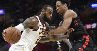 Cavaliers forward LeBron James (23) drives against Toronto Raptors guard DeMar DeRozan (10