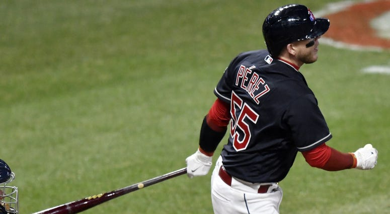 Apr 10, 2018; Cleveland, OH, USA; Cleveland Indians catcher Roberto Perez (55) hits a solo home run in the eighth inning against the Detroit Tigers at Progressive Field.