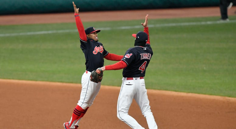 Apr 10, 2018; Cleveland, OH, USA; Cleveland Indians shortstop Francisco Lindor (12) and center fielder Bradley Zimmer (4) celebrate a win over the Detroit Tigers at Progressive Field.