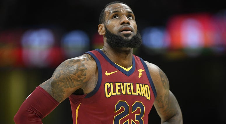 Cavaliers forward LeBron James (23) reacts in the first quarter against the New York Knicks at Quicken Loans Arena.