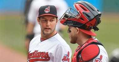 Apr 12, 2018; Cleveland, OH, USA; Cleveland Indians starting pitcher Trevor Bauer (47) walks to the dugout with catcher Roberto Perez (55) in the first inning at Progressive Field.