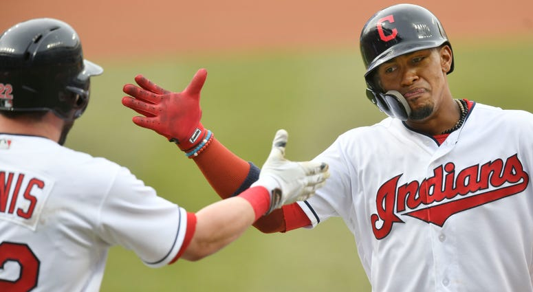 Apr 12, 2018; Cleveland, OH, USA; Cleveland Indians shortstop Francisco Lindor (12) celebrates his solo home run with second baseman Jason Kipnis (22) in the first inning against the Detroit Tigers at Progressive Field.