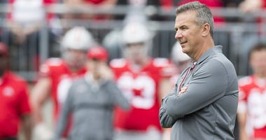 Ohio State Buckeyes head coach Urban Meyer watches as his team competes in the Spring Game at Ohio Stadium.