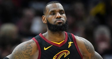 Cleveland Cavaliers forward LeBron James (23) reacts in the second quarter against the Indiana Pacers in game one of the first round of the 2018 NBA Playoffs at Quicken Loans Arena.