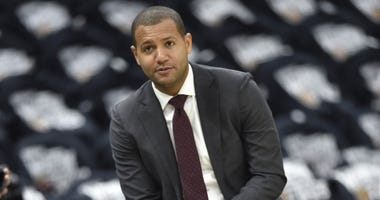 Cleveland Cavaliers general manager Koby Altman sits on the scorers table before a game against the Indiana Pacers in game one of the first round of the 2018 NBA Playoffs at Quicken Loans Arena.