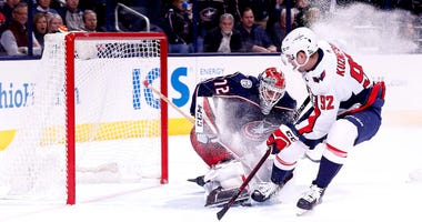 Columbus Blue Jackets goalie Sergei Bobrovsky (72) makes a save against Washington Capitals center Evgeny Kuznetsov (92) during overtime in game three of the first round of the 2018 Stanley Cup Playoffs at Nationwide Arena.