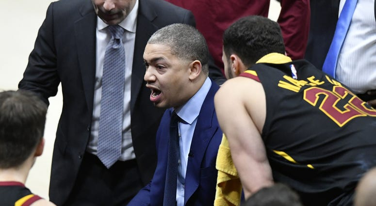 Cavaliers head coach Tyronn Lue calls a play during a timeout in the fourth quarter in game five of the first round of the 2018 NBA Playoffs at Quicken Loans Arena
